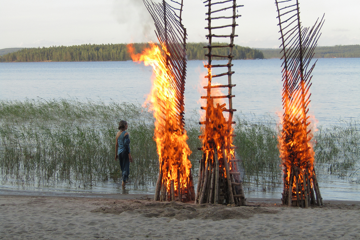 Burning of the birch ladders, Koli, Finland. 2018.  Live performance event.  Photographs and videos will become part of the Pori Art Museum Collection. (Photograph: Leena Jarva)